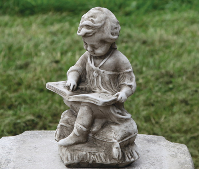 hand crafted stoneware child statues
