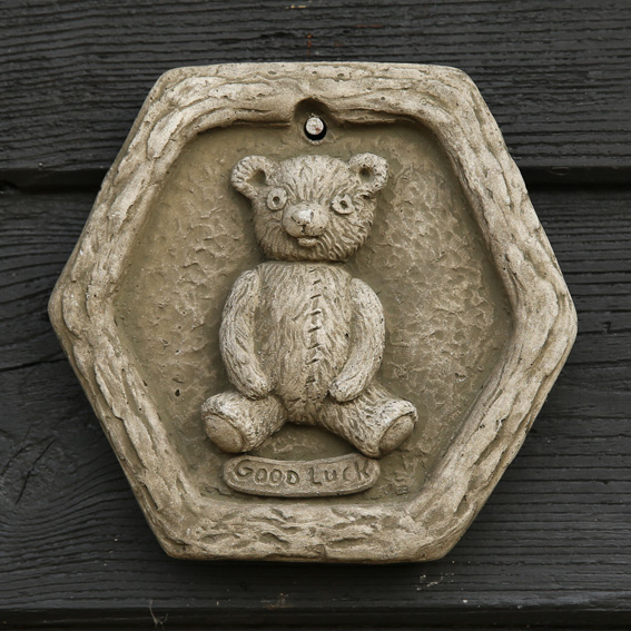 patched bear 'Good Luck' stone plaque