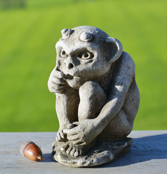 Miniature gremlin garden ornament made from hardwearing reconstituted stone
