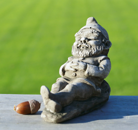 Miniature sleeping gnome garden ornament made from hardwearing reconstituted stone