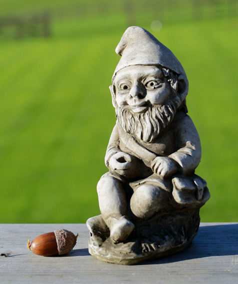 Miniature fishing gnome garden ornament made from hardwearing reconstituted stone.