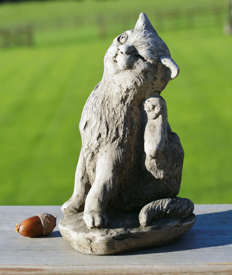 Miniature scratching cat garden ornament made from hardwearing reconstituted stone