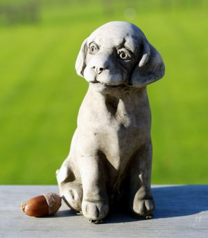 Miniature puppy garden ornament made from hardwearing reconstituted stone.