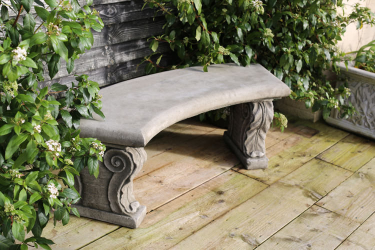decorative curved garden bench made from hardwearing reconstituted stone