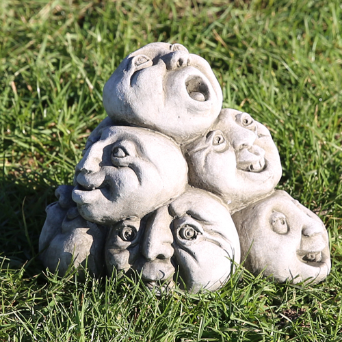 Fun pile of laughing faces made from hardwearing reconstituted limestone