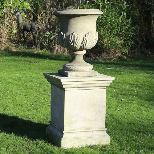 Distressed garden urn made from hardwearing reconstituted stone