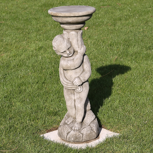 Classical boy sundial made from reconstituted limestone